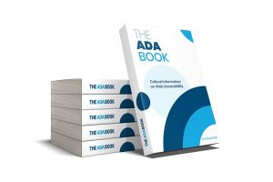 The ADA Book in paperback form with one book leaning on 5 books stacked behind it